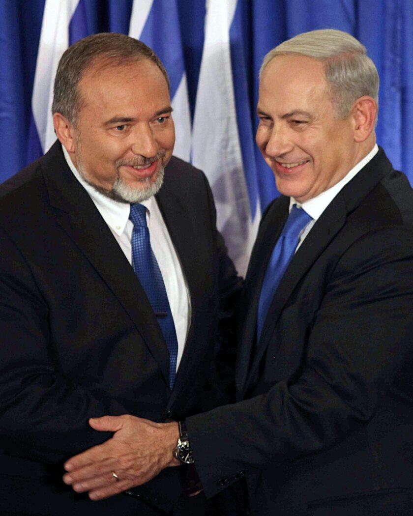 Israeli Prime Minister Benjamin Netanyahu, right, and Israeli Foreign Minister Avigdor Lieberman at a gathering in Jerusalem on Oct. 25.