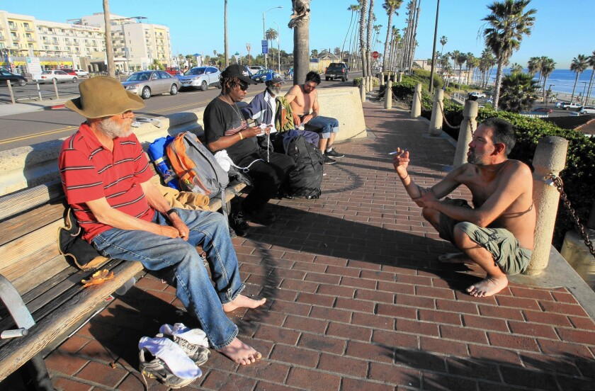 "A group of homeless men hang out near the Oceanside pier. ""We just try to seek out safety,"" said one."