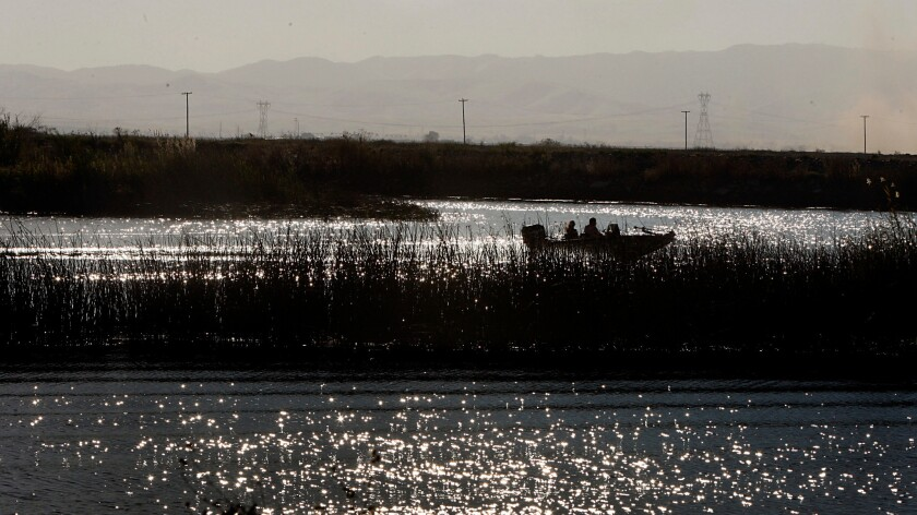 Boaters navigate the Middle River in the Sacramento River Delta in 2010.