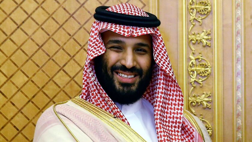 FILE - In this July, 23, 2017 file photo, Saudi Crown Prince Mohammed bin Salman poses while meeting