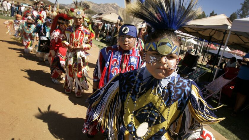 Children and others wearing traditional clothing at the Grand Entrance during the Barona Band of Mission Indians' annual Barona Powwow.