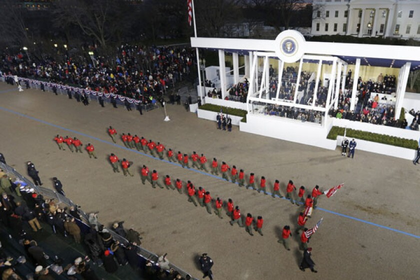 Boy Scout Troop 358 peforms while passing the presidential box during the Inaugural parade. The Boys Scouts of America announced that it is reconsidering excluding gays as leaders and youth members.