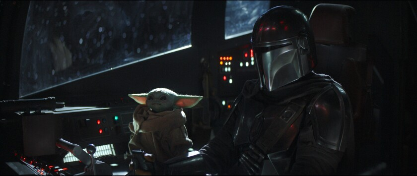 The Child and Mando in 'The Mandalorian'