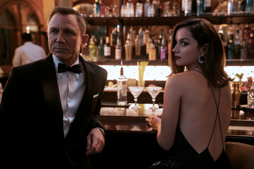"Daniel Craig and Ana de Armas at a fancy bar in ""No Time to Die."""