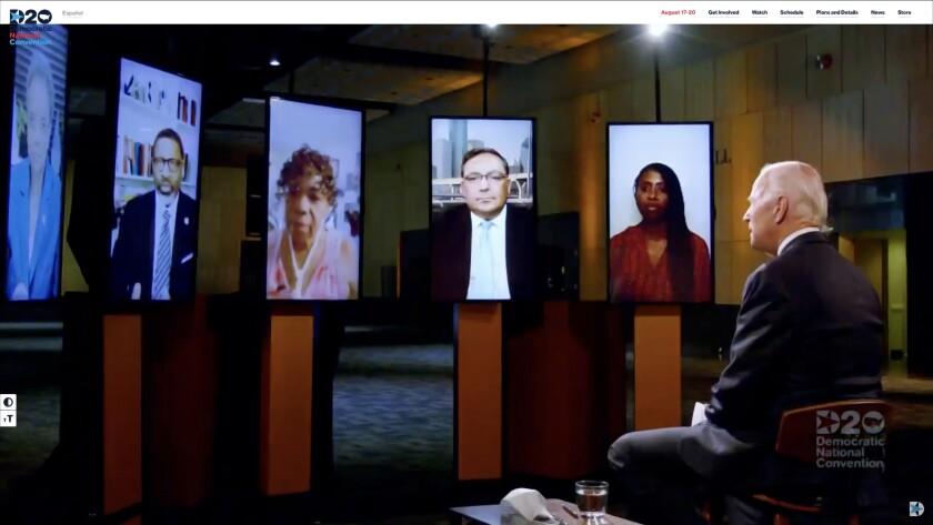 Joe Biden talks on a conference call with Lori Lightfoot, left, Derrick Johnson, Gwen Carr, Art Acevedo and Jamira Burley.