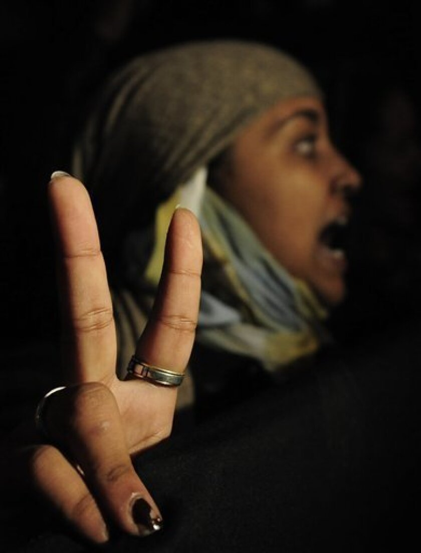 Saharan woman protests in front of the Morocco Embassy in Spain, Madrid, Monday, Nov. 8, 2010. At least three Moroccan security officials were killed and 70 injured Monday in a raid on a protest camp in the disputed territory of Western Sahara and unrest that then spread to a nearby city, where several buildings were set on fire. (AP Photo/Alvaro Barrientos)