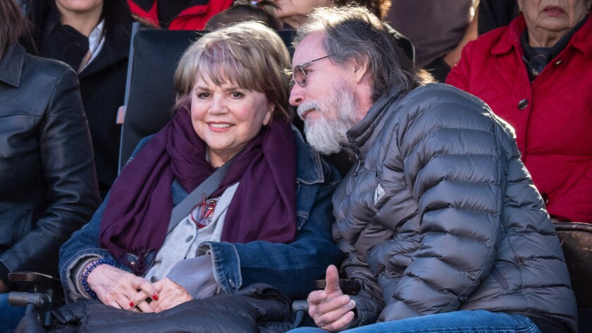 Linda Rondstadt and Jackson Browne watch the performances on a four-day visit to Ban?michi, populati