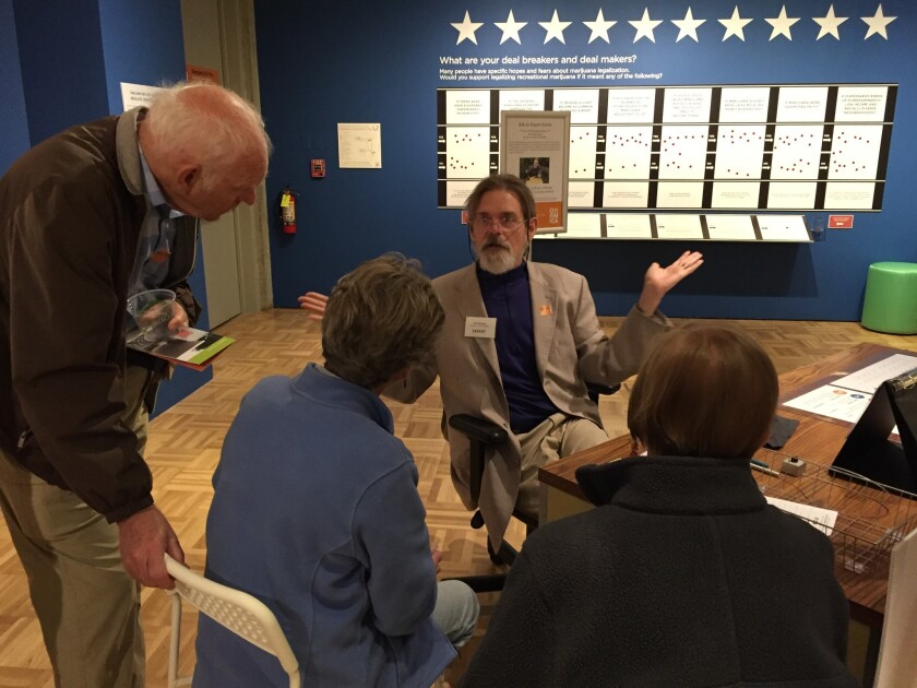 """Dale Gieringer, a coauthor of California's medical cannabis law, answers questions about marijuana at the Oakland Museum of California's """"Altered State"""" exhibit."""