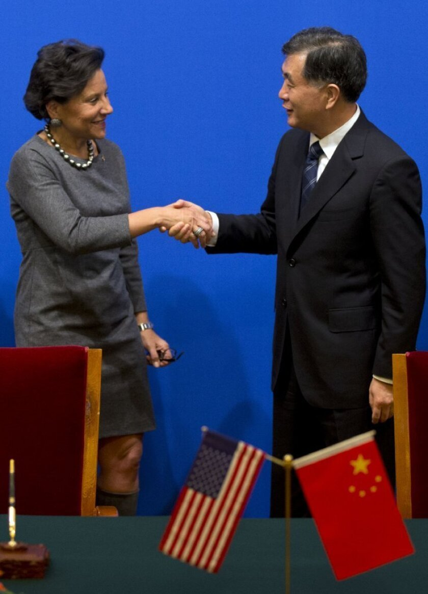 Chinese Vice Premier Wang Yang, right, shakes hands with U.S. Secretary of Commerce Penny Pritzker after Chinese and U.S. officials signed agreements at the 24th China-U.S. Joint Commission on Commerce and Trade held at Diaoyutai State Guesthouse in Beijing in December.
