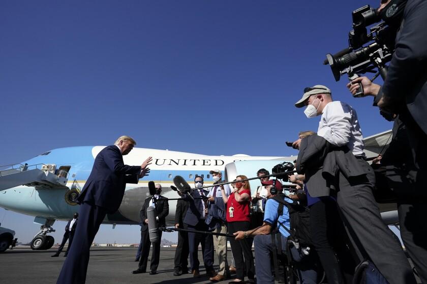 President Trump speaks to reporters Monday at Phoenix Sky Harbor International Airport.