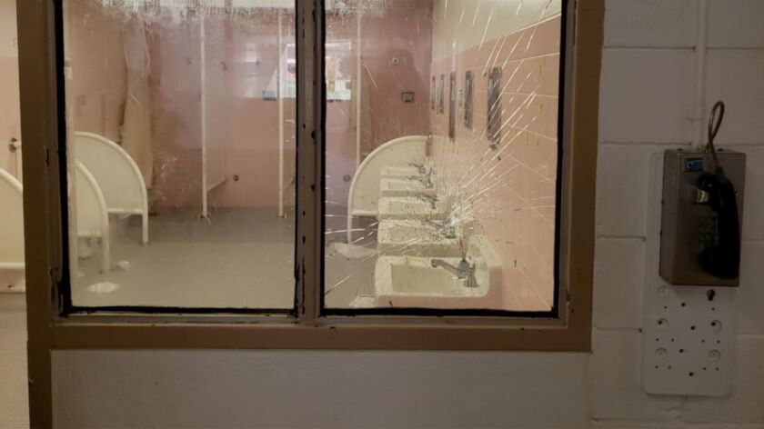 The shattered windows, smashed walls and gang graffiti uncovered at Barry J. Nidorf Juvenile Hall ar