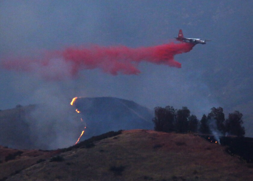 An air tanker drops flame retardant over the Sterling wildfire in the foothills above San Bernardino on June 25.