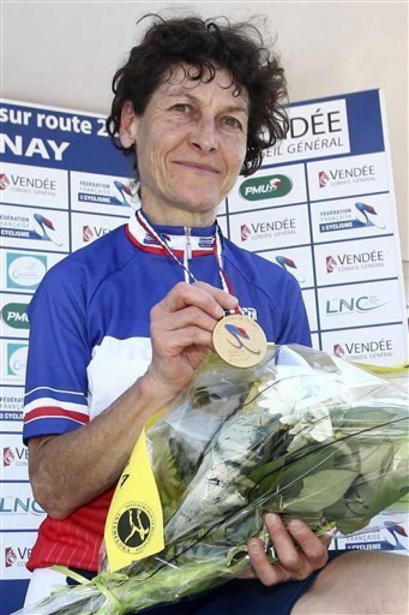 FILE -- This June 24, 2010 file photo shows Jeannie Longo on the podium displaying her gold medal after winning the 24.7 km race against the clock in the French cycling championship in Chantonnay, western France. A report in French sports newspaper L'Equipe says former Olympic and world champion cyclist Longo could face a maximum two-year suspension for breaking anti-doping rules requiring athletes to tell authorities where they can be located for testing. The report says the 52-year-old Longo broke the rules twice in the past 18 months and then again a third time on June 20, while training in the United States. (AP Photo/David Vincent, File)