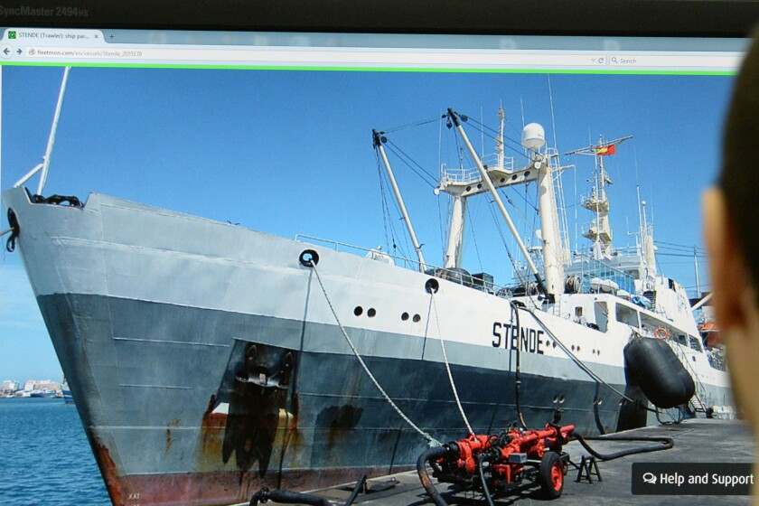 A Moscow man's computer screen displays a photo of a trawler like the Dalny Vostok.