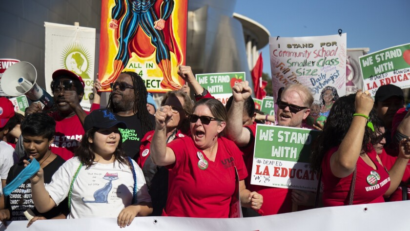 Hundreds of protesters joined in with UTLA to march for Public Education on Grand Avenue near the Broad Museum on Saturday.