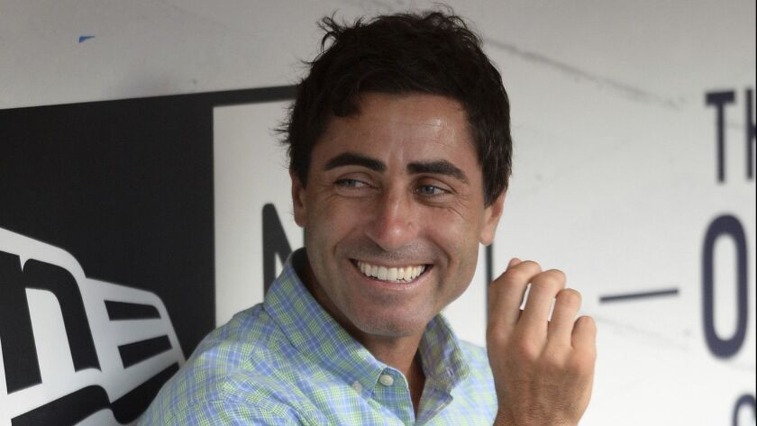 San Diego Padres general manager A.J. Preller laughs in the dugout before the baseball game against