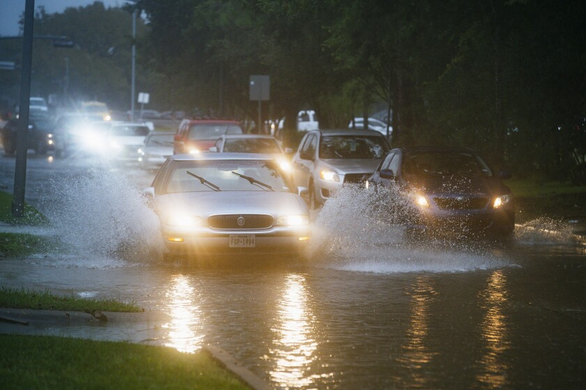 Cars splash through heavy water filling Chimney Rock, south of Brays Bayou, in Houston as Tropical Storm Imelda moved in Sept. 17.