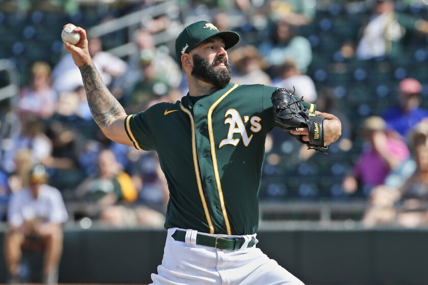 Oakland Athletics pitcher Mike Fiers pitches in the fourth inning of a spring training game against the Dodgers on Thursday in Mesa, Ariz.