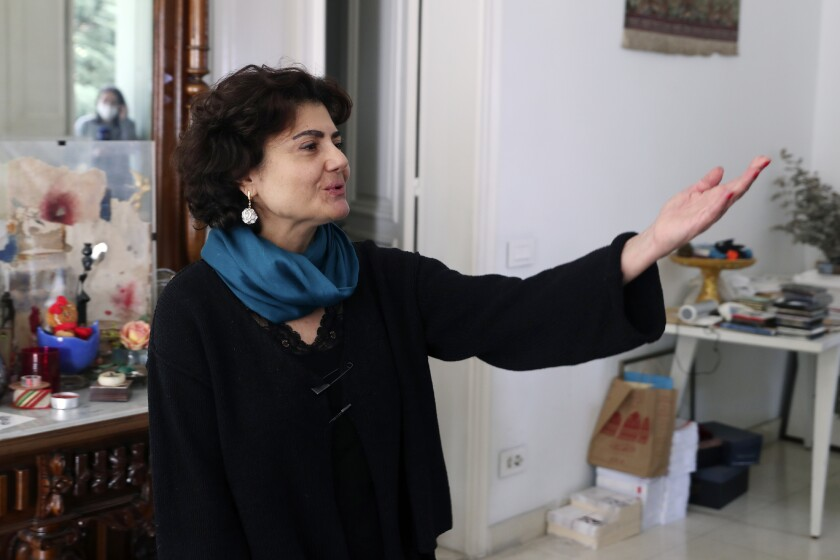 Rasha, sister of Lokman Slim, a longtime Shiite political activist and researcher, who has been found dead in his car, speaks to journalists at her house in the southern Beirut suburb of Dahiyeh, Lebanon, Thursday, Feb. 4, 2021. (AP Photo/Bilal Hussein)