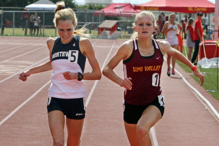 Bethan Knights of Northwood (left) and Sarah Baxter of Simi Valley finish tied with a time of 10:07:52 in the 3,200 meters Saturday at the Mt. Carmel Invitational.