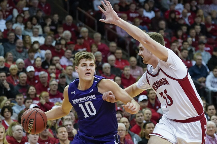 Northwestern's Miller Kopp (10) drives against Wisconsin's Nate Reuvers (35) during the first half of an NCAA college basketball game Wednesday, March 4, 2020, in Madison, Wis. (AP Photo/Andy Manis)