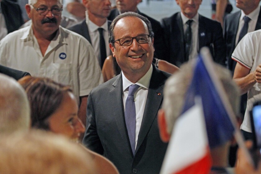 French President Francois Hollande meets the public in Rivesaltes in southern France on July 28.