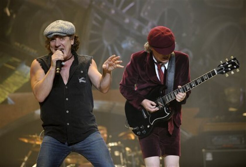 file - In this Nov. 12, 2008 file photo, AC/DC lead singer Brian Johnson, left, and Angus Young perform on the Black Ice tour at Madison Square Garden in New York. As part of the biggest and most enduring bands in the world, Young and Johnson believe that early struggles got them to where they are