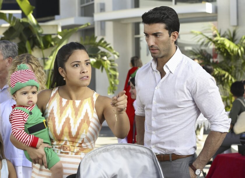 "Gina Rodriguez and Justin Baldoni in ""Jane the Virgin."""