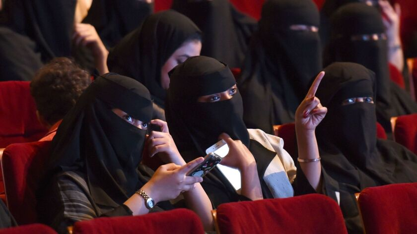 """Saudi women attend the """"Short Film Competition 2"""" festival at King Fahad Culture Center in Riyadh."""