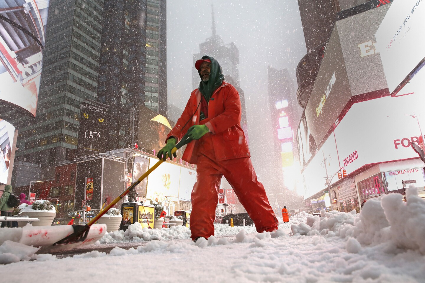 New York city employee Ronney Wade shovels snow in Time Square on Tuesday morning.