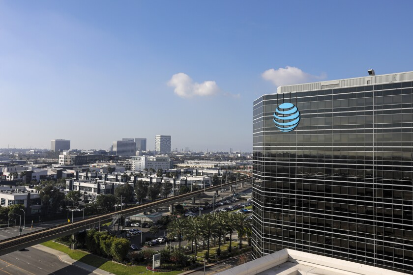 A view of the exterior of a multistory glass building with the AT&T logo.