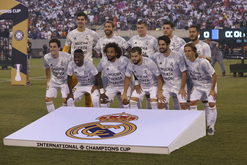 The Real Madrid starting eleven pose for a photo before the first half of an International Champions Cup soccer match, Friday, July 26, 2019, in East Rutherford, N.J. Atletico Madrid won 7-3. (AP Photo/Steve Luciano)