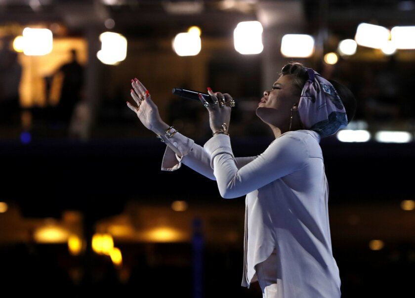 Singer Andra Day performs during the second day session of the Democratic National Convention in Philadelphia, Tuesday, July 26, 2016. (AP Photo/Carolyn Kaster)