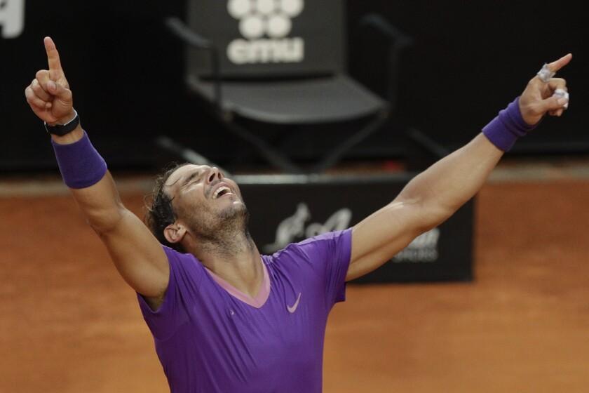 Spain's Rafael Nadal celebrates after defeating Serbia's Novak Djokovic at their final match of the Italian Open tennis tournament, in Rome, Sunday, May 16, 2021. Nadal won 7-5, 1-6, 6-3. (AP Photo/Gregorio Borgia)