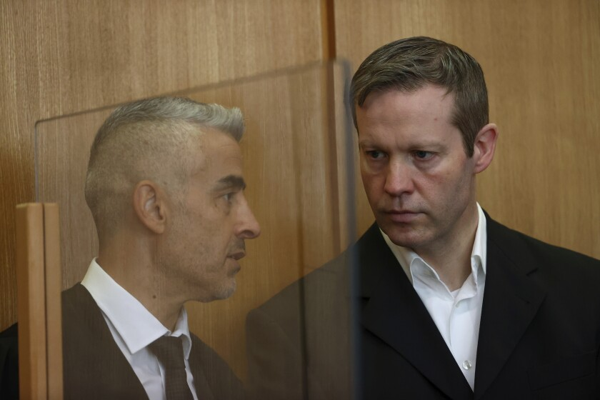 Stephan Ernst, who is accused of murdering politician Walter Luebcke, listens to his lawyer Mustafa Kaplan at his trial at the Oberlandesgericht Frankfurt courthouse, in Frankfurt, Germany, Wednesday, August 5, 2020. Stephan Ernst acknowledged that he filed the fatal shot in a statement by his lawyer to the Frankfurt state court on Wednesday, news agency dpa reported. (Kai Pfaffenbach/Pool via AP)