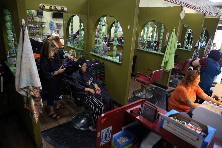 Marta Vasquez does Margarita Cortez's hair