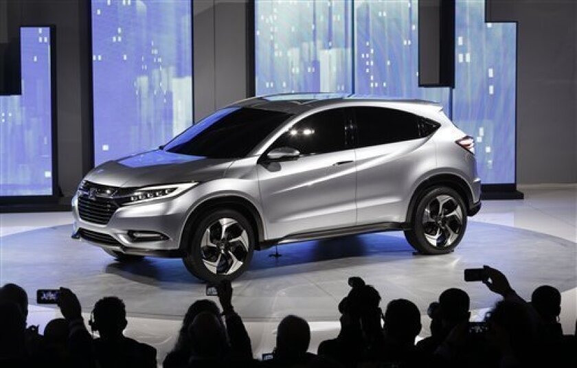 The Honda Urban SUV Concept is shown at media previews for the North American International Auto Show in Detroit, Monday, Jan. 14, 2013. (AP Photo/Paul Sancya)
