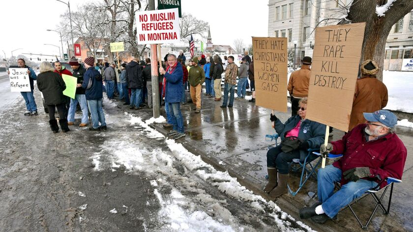 Both sides of the refugee issue demonstrate in Missoula, Mont., last year.