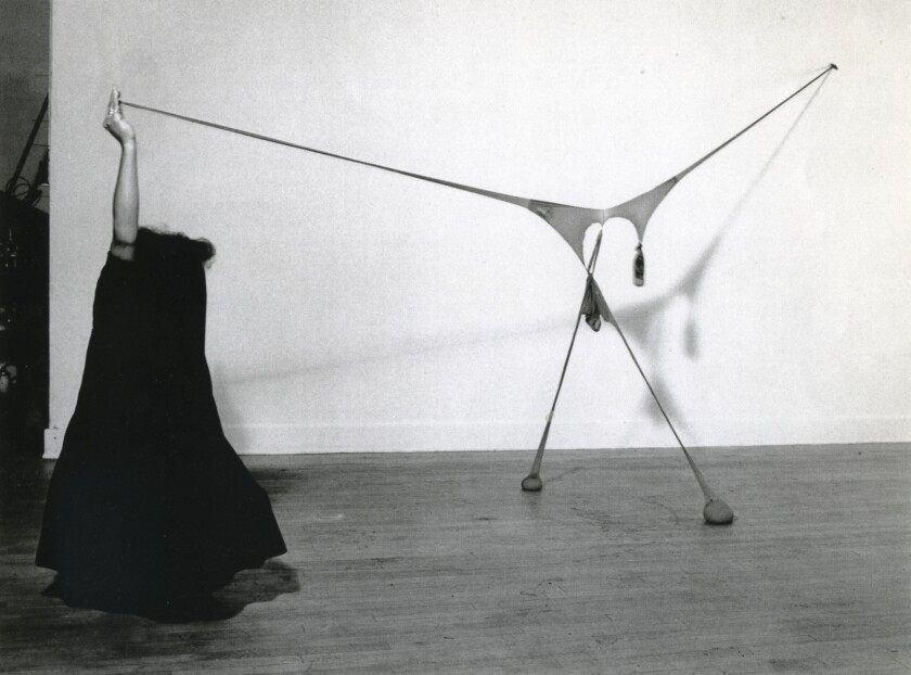 "Senga Nengudi. ""Studio performance with R.S.V.P."" 1976. Black and white photograph. Framed: 30 1/2 Ã"