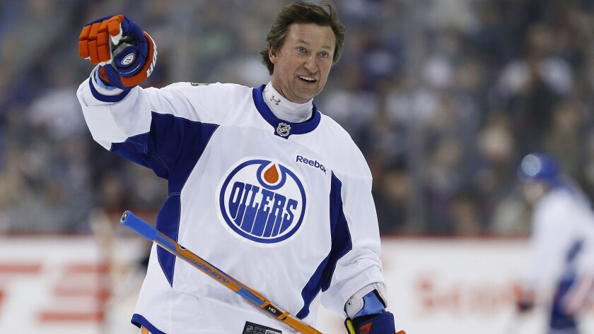 Hall of Famer Wayne Gretzky waves to the crowd during a practice for the NHL's Heritage Classic Alumni game in Winnipeg on Oct. 21. He recently returned to the NHL as an Edmonton Oilers executive.