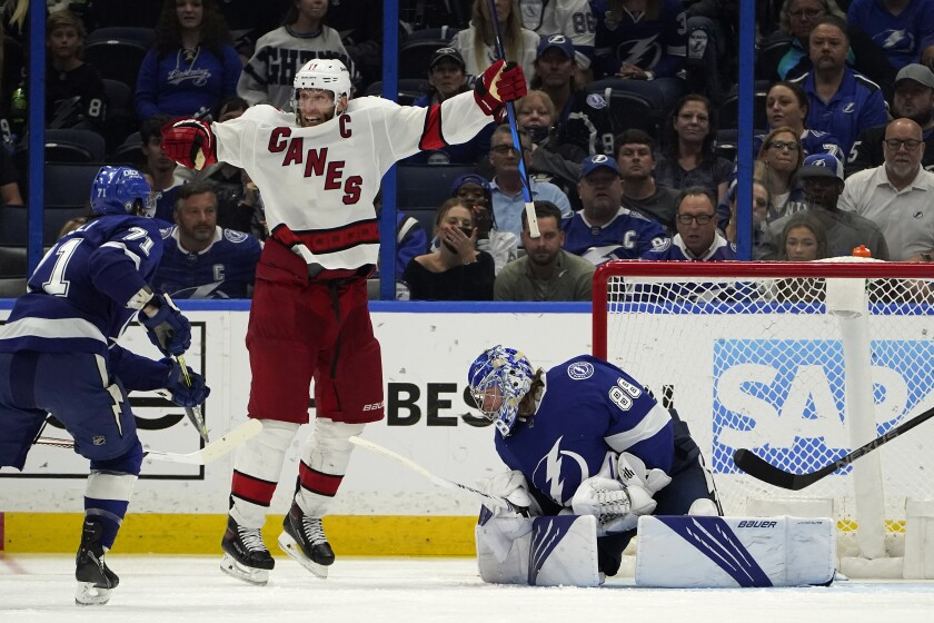 Carolina Hurricanes center Jordan Staal (11) celebrates after right wing Sebastian Aho scored past Tampa Bay Lightning goaltender Andrei Vasilevskiy (88) during overtime in Game 3 of an NHL hockey Stanley Cup second-round playoff series Thursday, June 3, 2021, in Tampa, Fla. (AP Photo/Chris O'Meara)