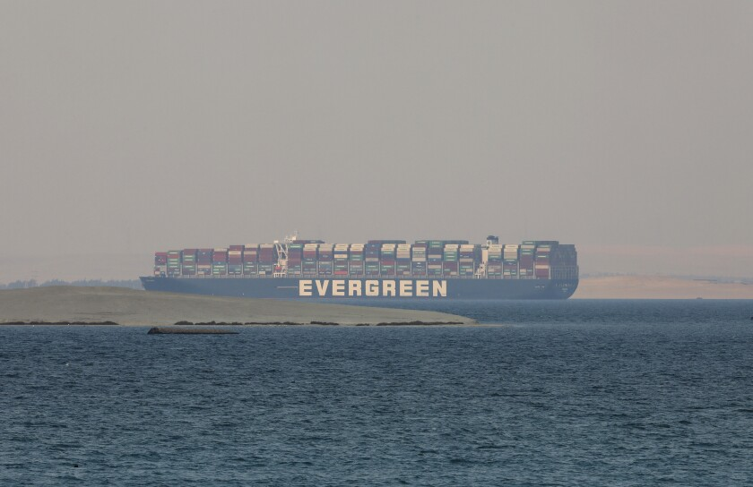 FILE - In this March 30, 2021 file photo, the Ever Given, a Panama-flagged cargo ship, is seen in Egypt's Great Bitter Lake. The Suez Canal chief said Tuesday, April 6, 2021, that authorities are negotiating a financial settlement with the owners of the massive vessel that blocked the crucial waterway for nearly a week. (AP Photo/Mohamed Elshahed, File)
