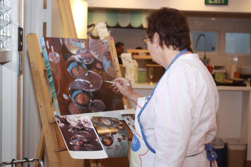 Artist Dana Levine provides a demonstration of her painting techniques.
