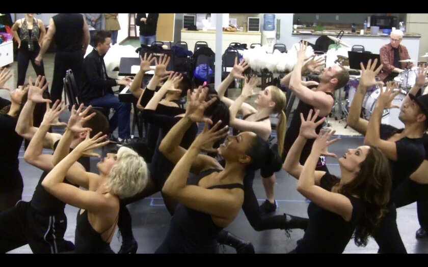 """The cast members of San Diego Musical Theatre's """"Chicago"""" get their jazz hands on during rehearsal."""