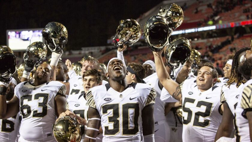 Wake Forest's Ja'Cquez Williams (30) celebrates with his team after defeating North Carolina State.