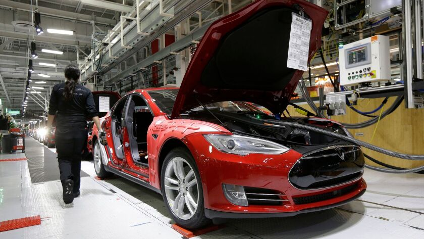 Several lawsuits filed recently claim workers faced discrimination at Tesla's factory in Fremont, Calif.