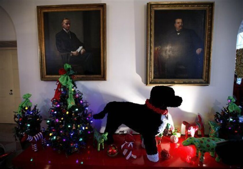 "An oversized version of Bo, the Obama family dog, made of pipe cleaners, is displayed in the Booksellers area of the White House in Washington, Wednesday, Dec. 1, 2010. The theme for the White House Christmas 2010 is ""Simple Gifts"". (AP Photo/Charles Dharapak)"