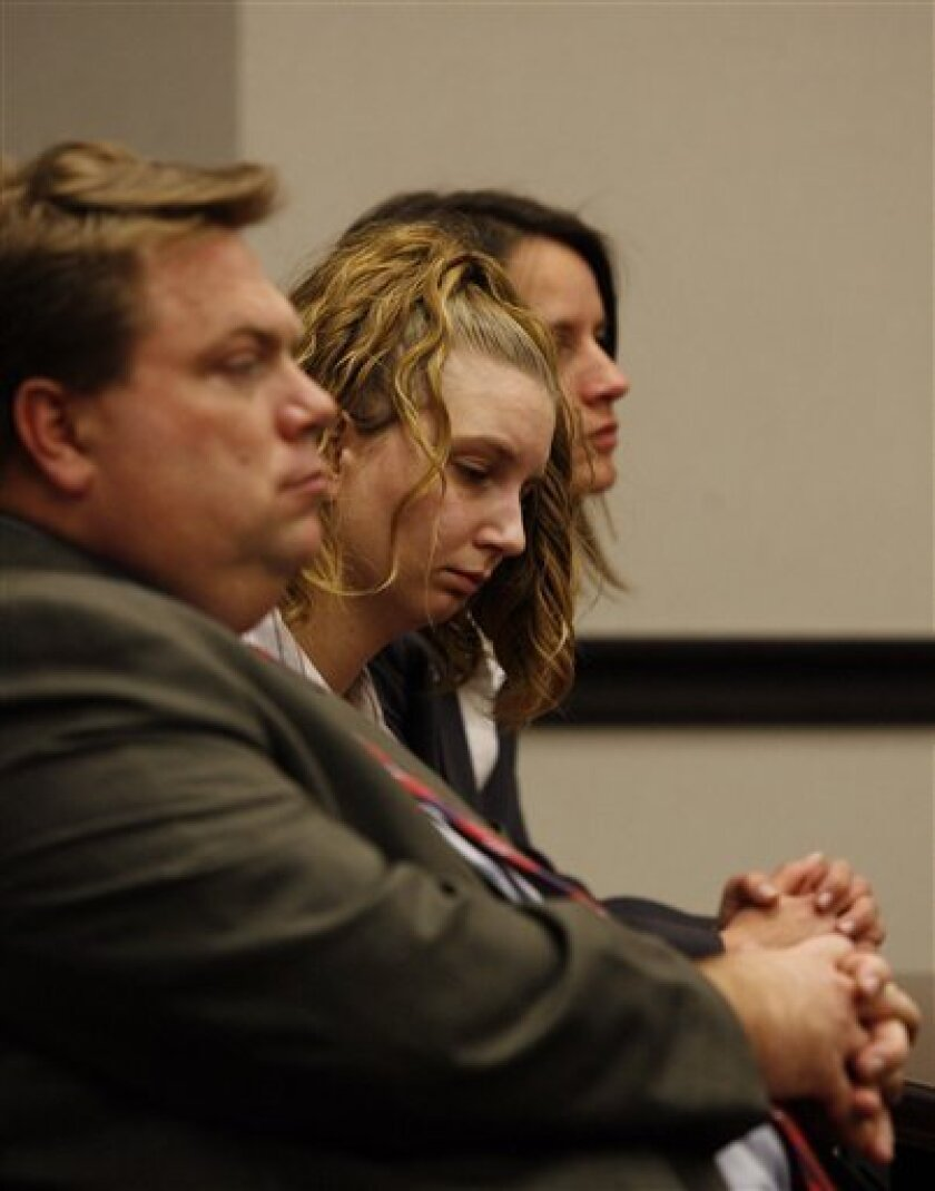 "Kimberly Dawn Trenor, 20, reacts as Judge David Garner polls the jury Monday Feb. 2, 2009 after finding Trenor guilty of capital murder for the 2007 death of her daughter Riley Ann Sawyers, known as ""Baby Grace."" Trenor and her husband, Royce Clyde Zeigler II, were accused of killing Riley Ann Sawyers while trying to discipline the girl. Zeigler's capital murder trial is scheduled later. The toddler's remains were found in Galveston Bay in October 2007. Relatives in Ohio saw news reports about the girl and identified her. (AP Photo/Pool, Jennifer Reynolds)"