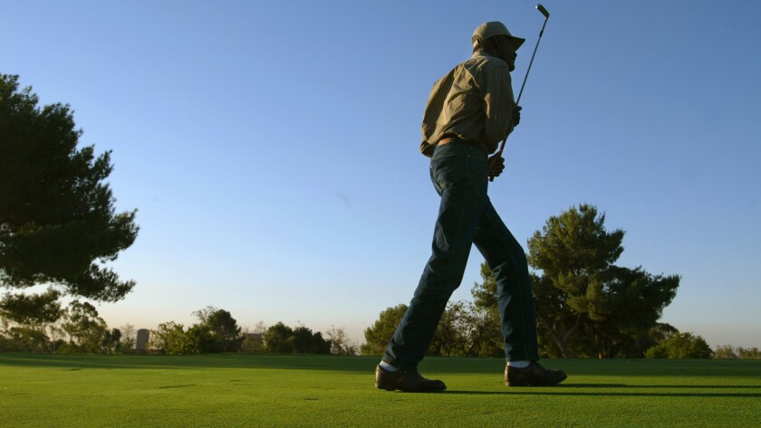 Vietnam veteran Walter Donaldson plays on the nine-hole Heroes Golf Course in Westwood in 2002. A fundraiser to repair and maintain the golf course is being held Wednesday.