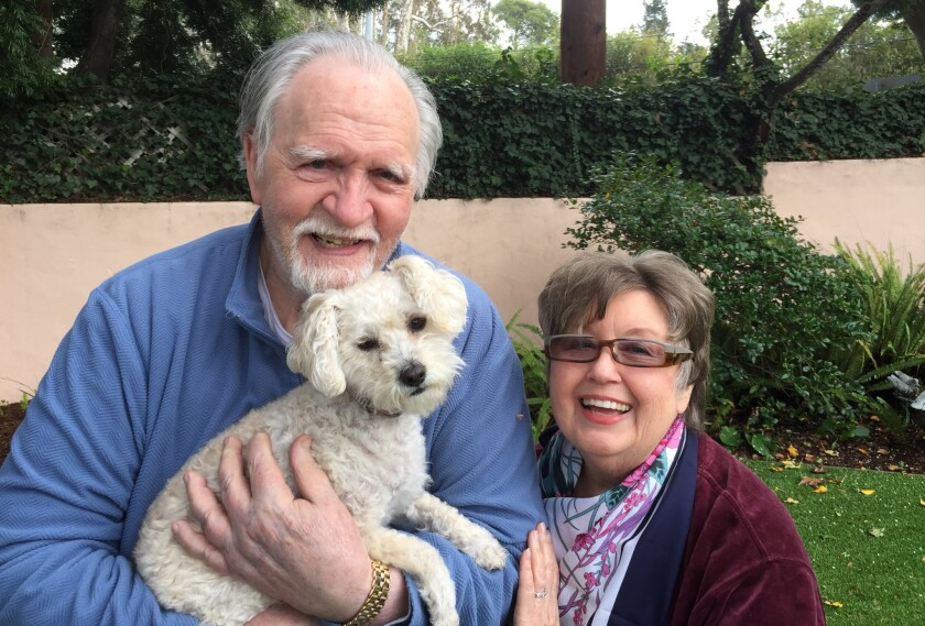 Jim and Alice Mitchell with their dog, Gigi.